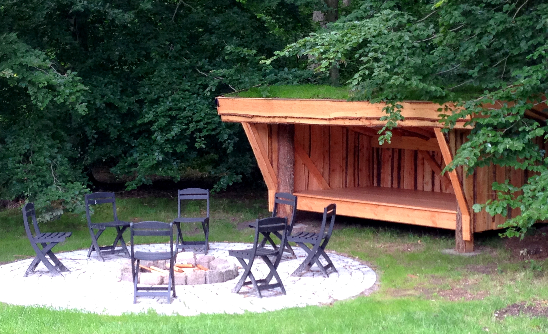 Outdoor firepit and sleeping platform